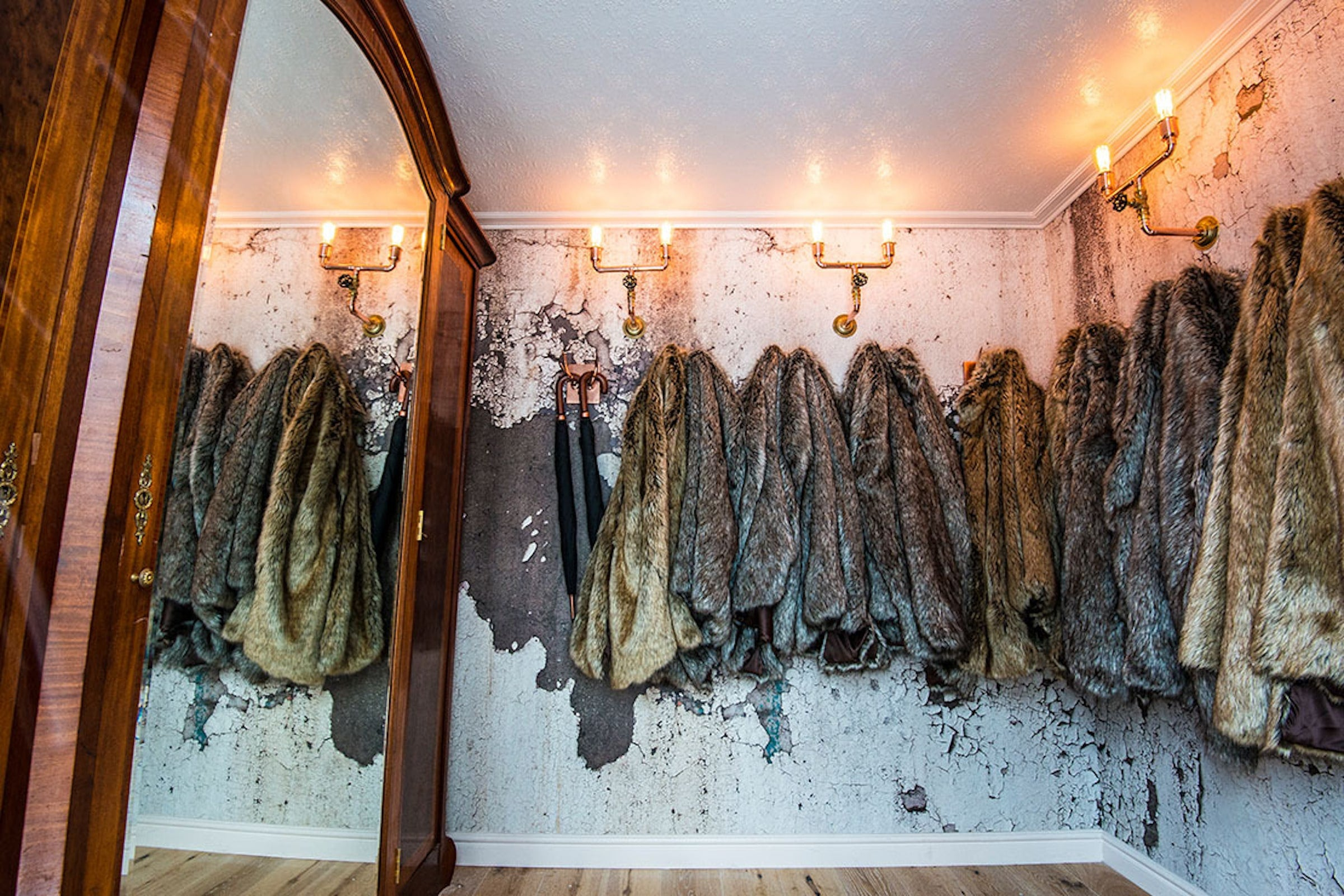Fur coats in the Elyx Trailer in the woods