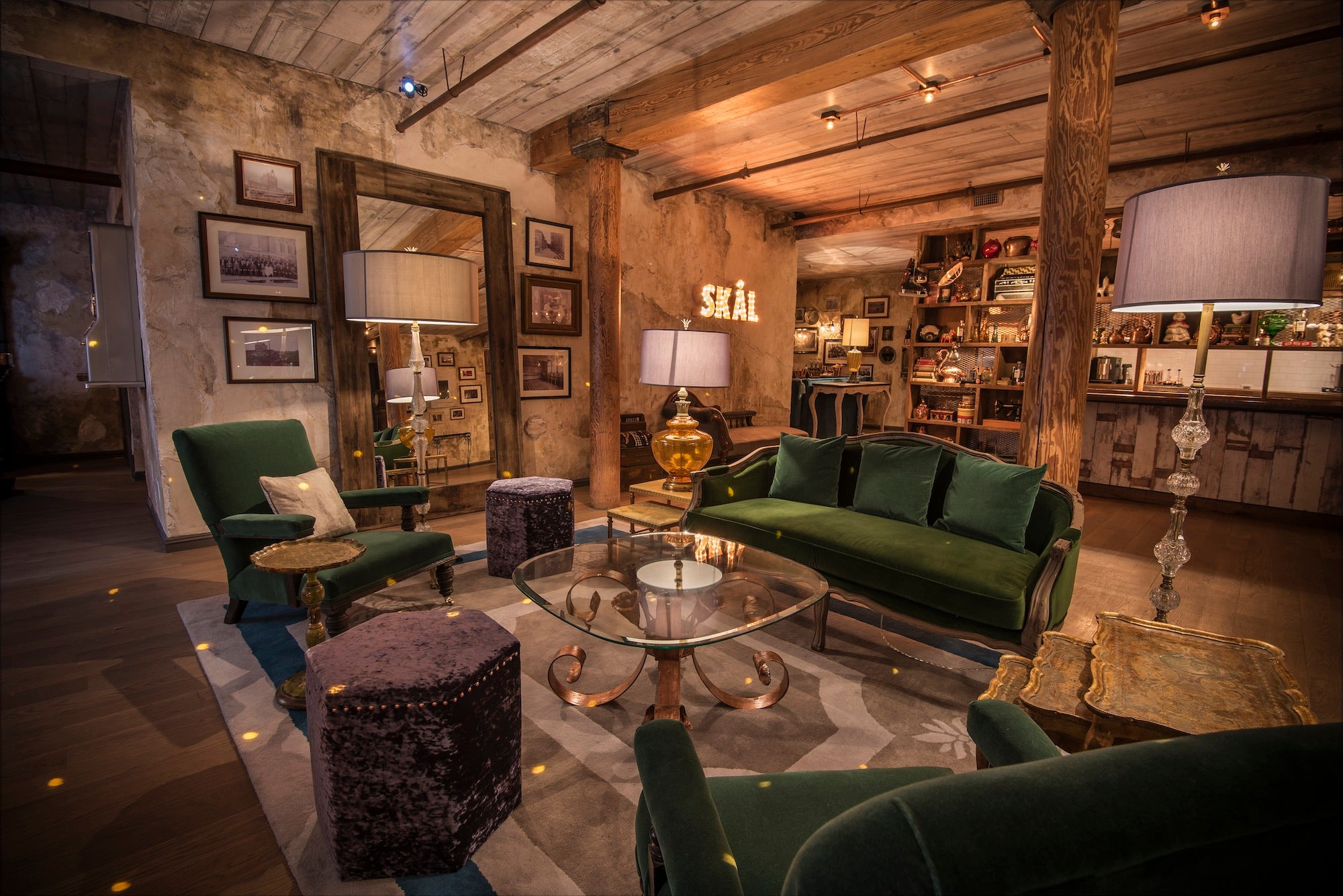 Green couches at the Elyx House NYC