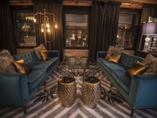Turquoise couches at the Elyx House NYC