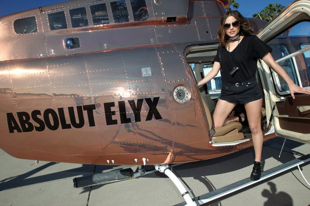 Olivia Culpo Boards The Absolut Elyx Copper Chopper To Coachella